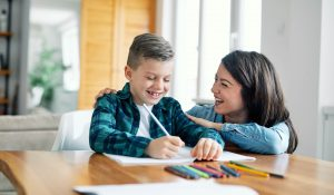 A mom no longer wondering what is best-guess spelling and now happily helping her son with homework.